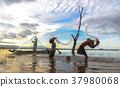 Asian boy and girl playing in the river 37980068