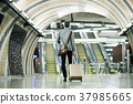 Businessman in front of escalators on a metro 37985665
