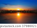 background with panorama of city clouds and suns 37986021