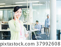 Business woman (telephone) 37992608