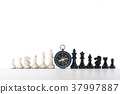 Chess and navigation compass on chessboard in conc 37997887