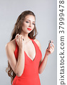 woman in red dress with perfume 37999478