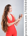 woman in red dress with perfume 37999484