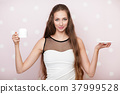woman holding an empty white cup 37999528