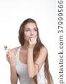 woman applying perfume on her wrist 37999566