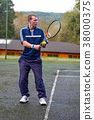 Male playing Tennis 38000375