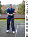 Male playing Tennis 38000377