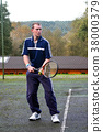 Male playing Tennis 38000379