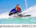 Teenager on jet ski. Teen age boy water skiing. 38001519