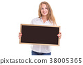 Beautiful caucasian woman in white shirt and holding blank blackboard. Studio shooting isolated on white 38005365
