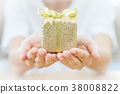 Woman hand holding gift box. 38008822