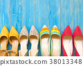 Collection of women's shoes on blue background 38013348