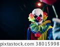 Photo of clown with red balloon at night on street 38015998