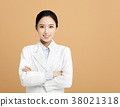 Smiling asian woman pharmacist doctor isolated 38021318
