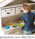 toddler girl playing with toy kitchen at home 38022635