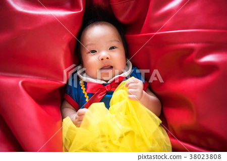 Curious Asian baby with fantasy dress 38023808