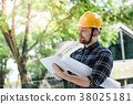 Male engineer at a construction site with a tablet 38025181