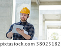 Male engineer at a construction site with a tablet 38025182