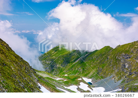 valley of Fagaras mountains in clouds 38026667