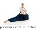 Aikido master practices defense posture. Healthy 38027641