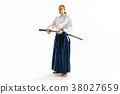 The young man are training Aikido at studio 38027659