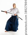 The young man are training Aikido at studio 38027664