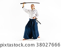 The young man are training Aikido at studio 38027666
