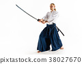 The young man are training Aikido at studio 38027670