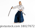 The young man are training Aikido at studio 38027672