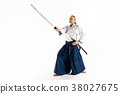 The young man are training Aikido at studio 38027675