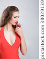 woman in red dress with perfume 38029139