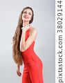 woman in red dress with perfume 38029144