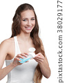 woman hold cotton pad and tonic 38029177