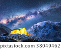 Milky Way, yellow tent and mountains. Space 38049462