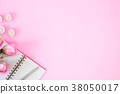 Notebook and pen with pink rose flower on pink. 38050017