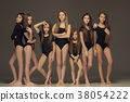 The group of teen girls posing at white studio 38054222