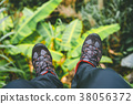 Hanging feet with trakking footwear after long 38056372