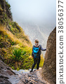 Woman hiker with backpack in rocky terrain on a 38056377