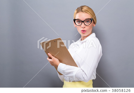 Office woman with a clipboard 38058126