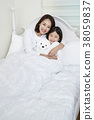 A cordial mommy and little girl, family concept photo 156 38059837