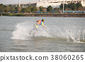 Surfing at the water sports arena. 38060265