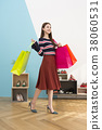 Everyday life of beautiful young woman, shopping, working concept photo in studio shot white background. 338 38060531