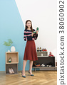 Everyday life of beautiful young woman, shopping, working concept photo in studio shot white background. 326 38060902