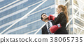 businessperson and boxing gloves attacking 38065735