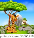 adventurer and giraffe posing with mountain scene 38065919