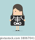 Businesswoman is getting x-ray examination. 38067041
