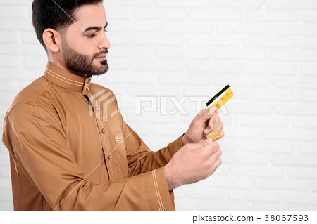 Young Arabian man keeps bitcoin and golden credit 38067593