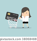 Businesswoman with credit card in shopping cart 38068488
