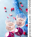 Two stemmed glasses with champagne on blue 38070668