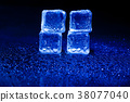 Blue ice cubes on black background. 38077040